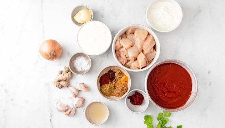 ingredients for chicken tikka masala measured into bowls