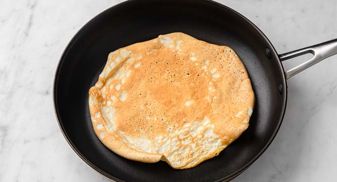 a crepe in a frying pan