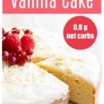 a slice of vanilla coconut flour cake taken from a full cake, topped with sugar free icing and berries