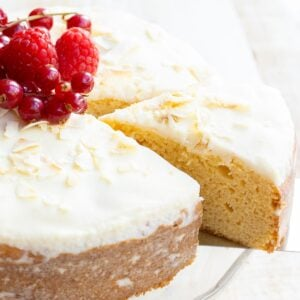 a coconut flour cake with icing and topped with fruit