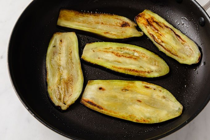 sliced eggplant in a frying pan