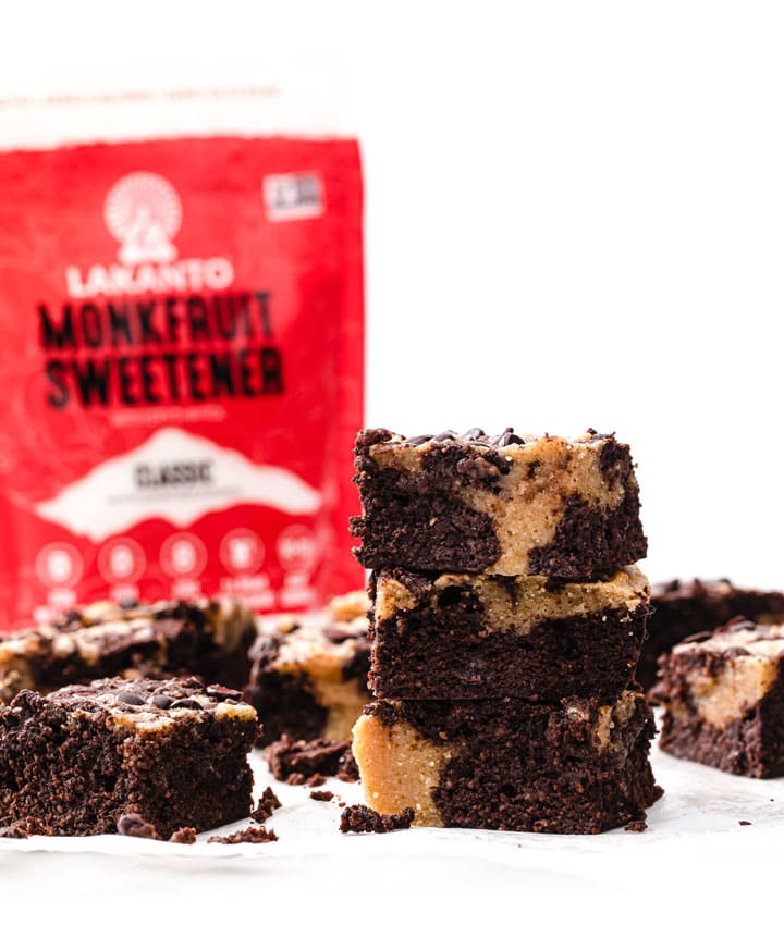 sugar free pb brownies stacked on top of each other with a pack of Lakanto monk fruit sweetener