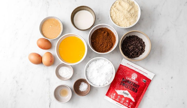 ingredients for brownies with peanut butter swirl measured into bowls