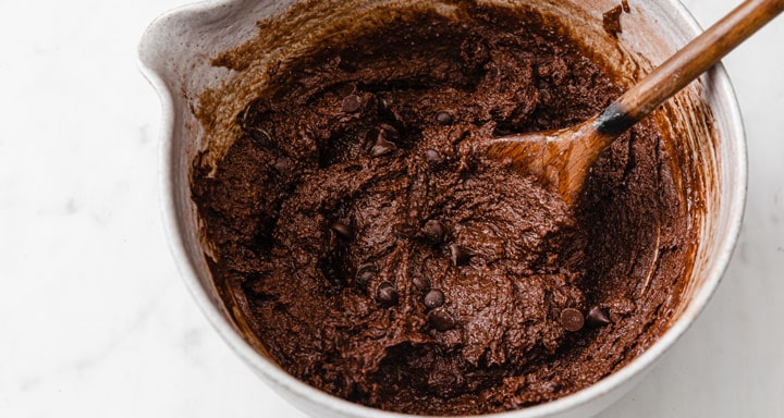brownie batter in a bowl with a spoon