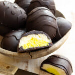 sugar free easter eggs made with chocolate and a mascarpone filling, one is sliced open showing the inside