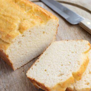 keto coconut flour bread loaf sliced on a wooden bard
