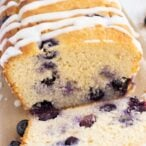 keto blueberry bread topped with lemon drizzle sliced open