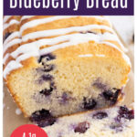 a loaf of blueberry bread sliced open, topped with lemon drizzle