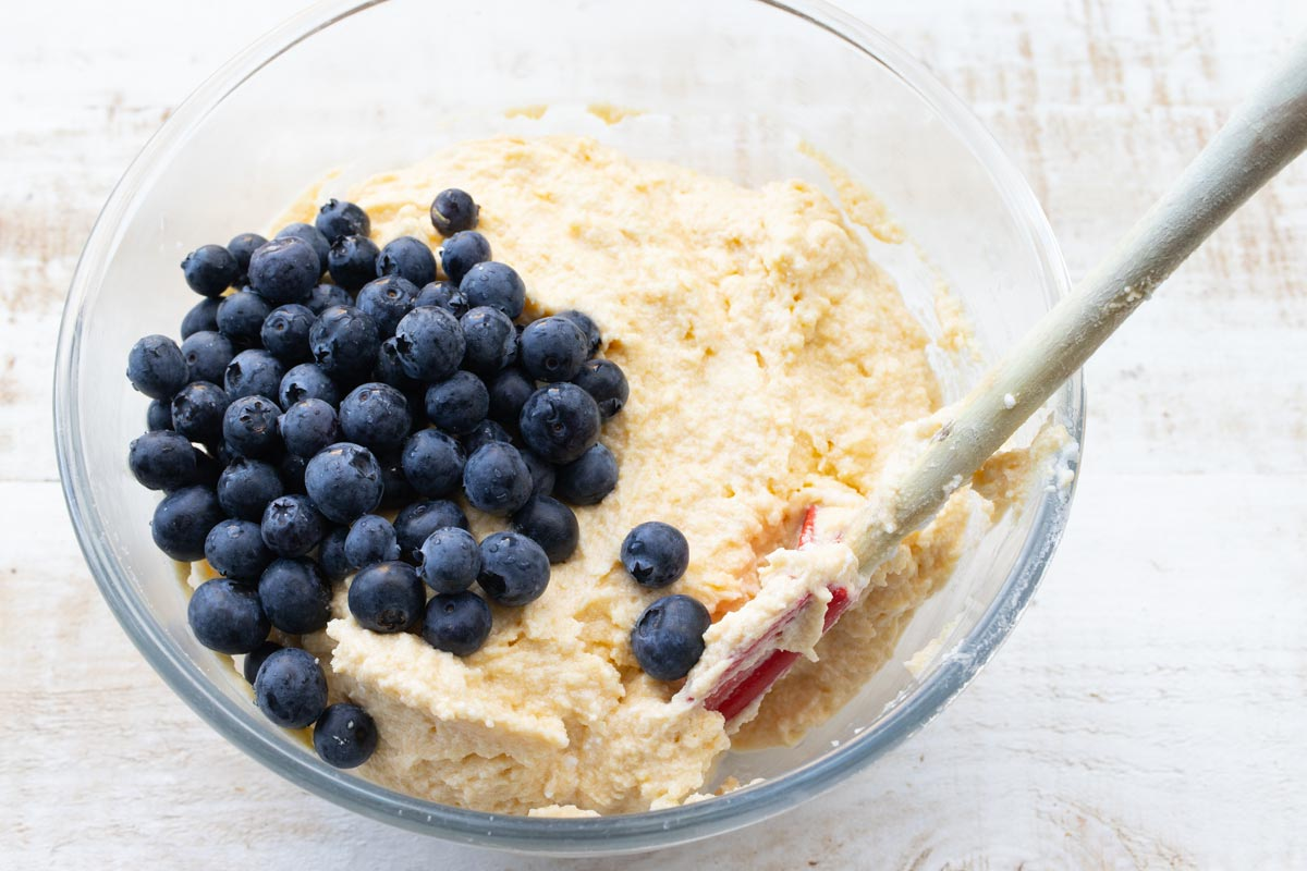 almond flour batter and blueberries in a bowl with a spatula