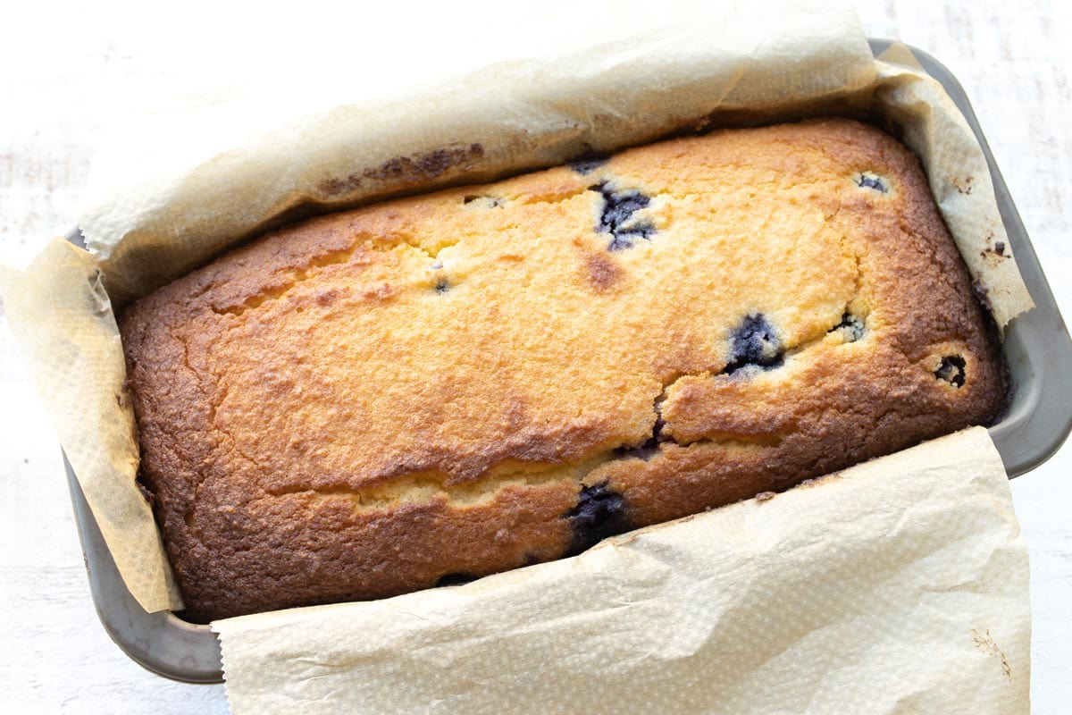 baked blueberry bread in the loaf tin