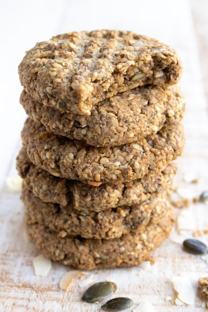 stack of keto breakfast cookies, the top one is bitten into