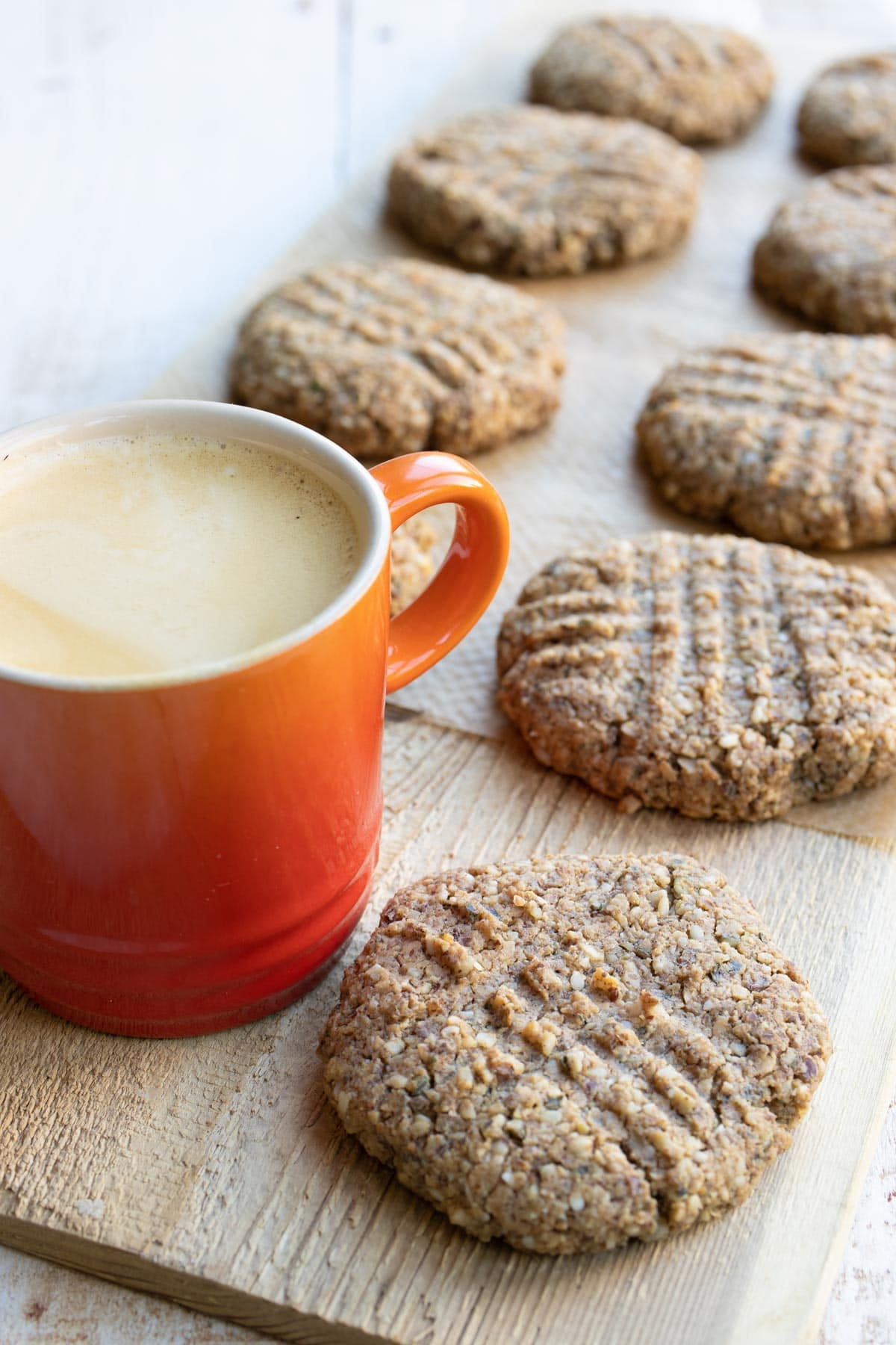 low carb breakfast cookies on a wooden board with a cup of coffee