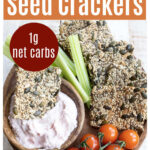 a snack platter with keto seed crackers, dip and vegetables