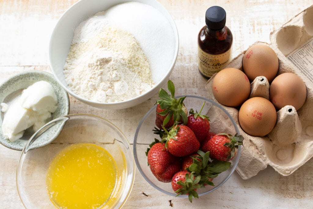 ingredients for strawberry muffins measured into bowls