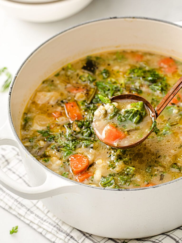 a pot with keto vegetable soup and a ladle
