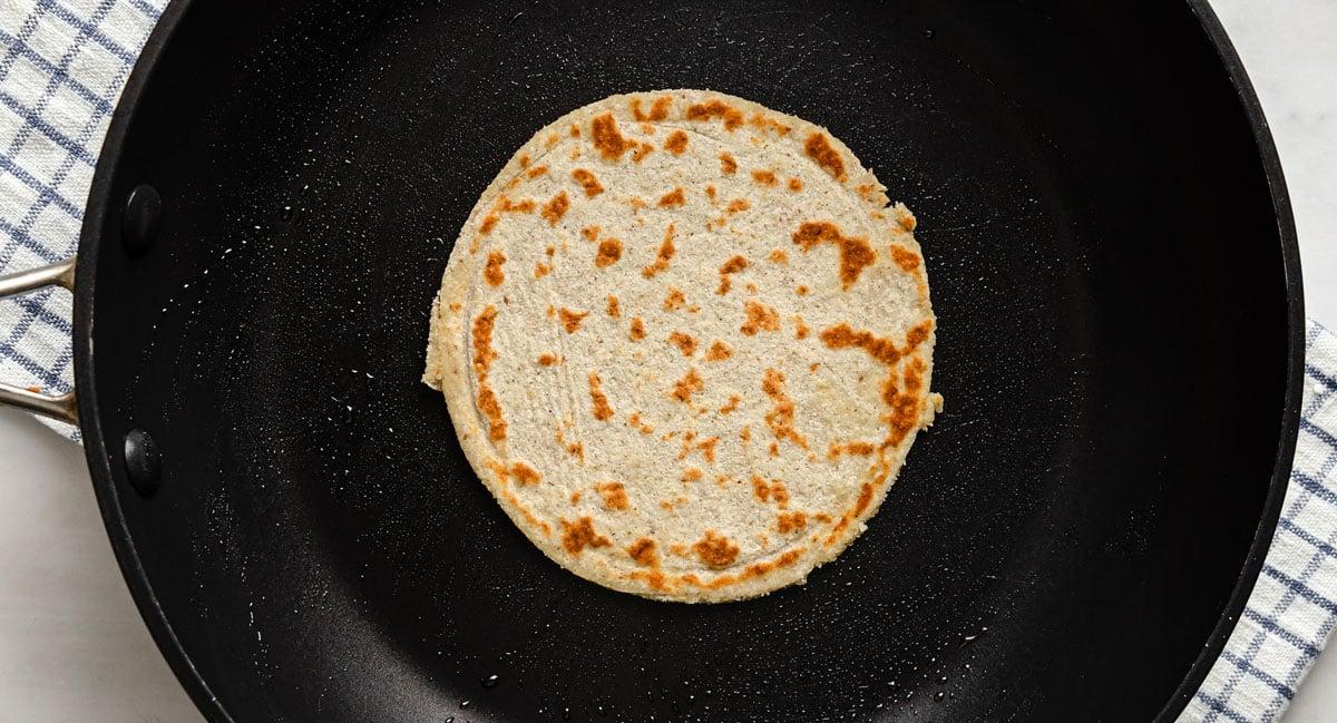 a fried tortilla in a frying pan