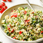 a bowl filled with keto tabbouleh made with cauliflower and a spoon