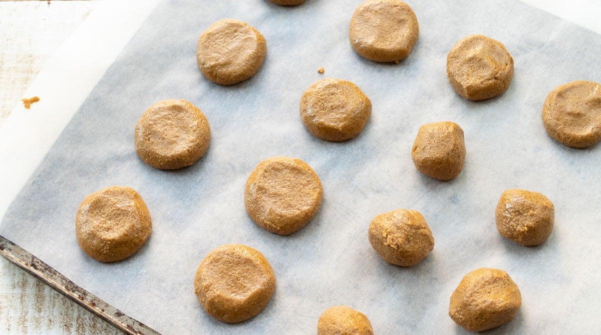 peanut butter cookie dough balls on parchment paper