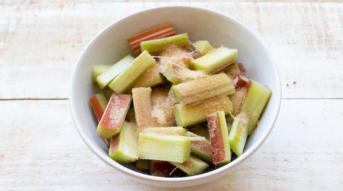 rhubarb pieces and sweetener in a bowl