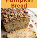 a sliced loaf of pumpkin bread topped with a pecan crust