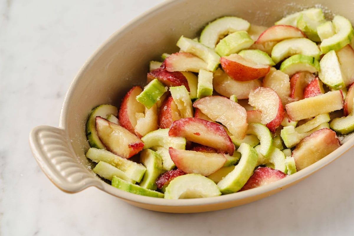 peach and zucchini slices in a casserole