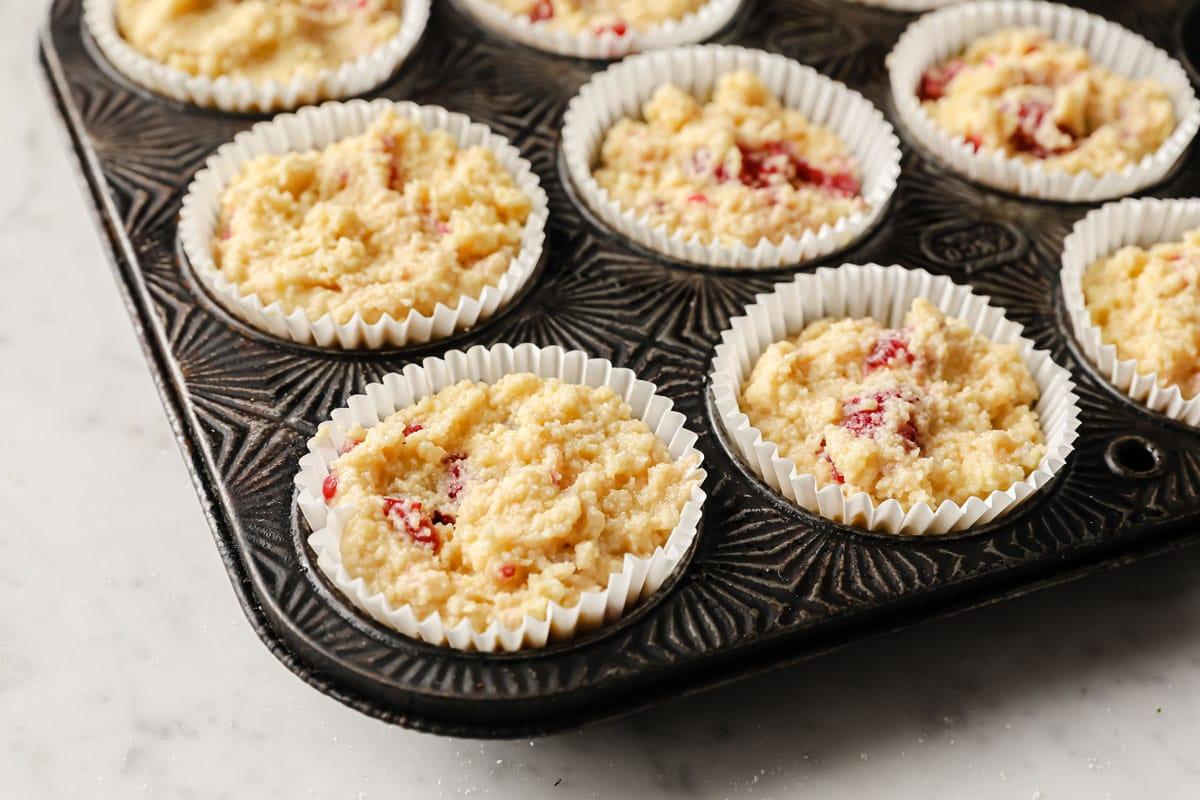 muffin batter in paper cups