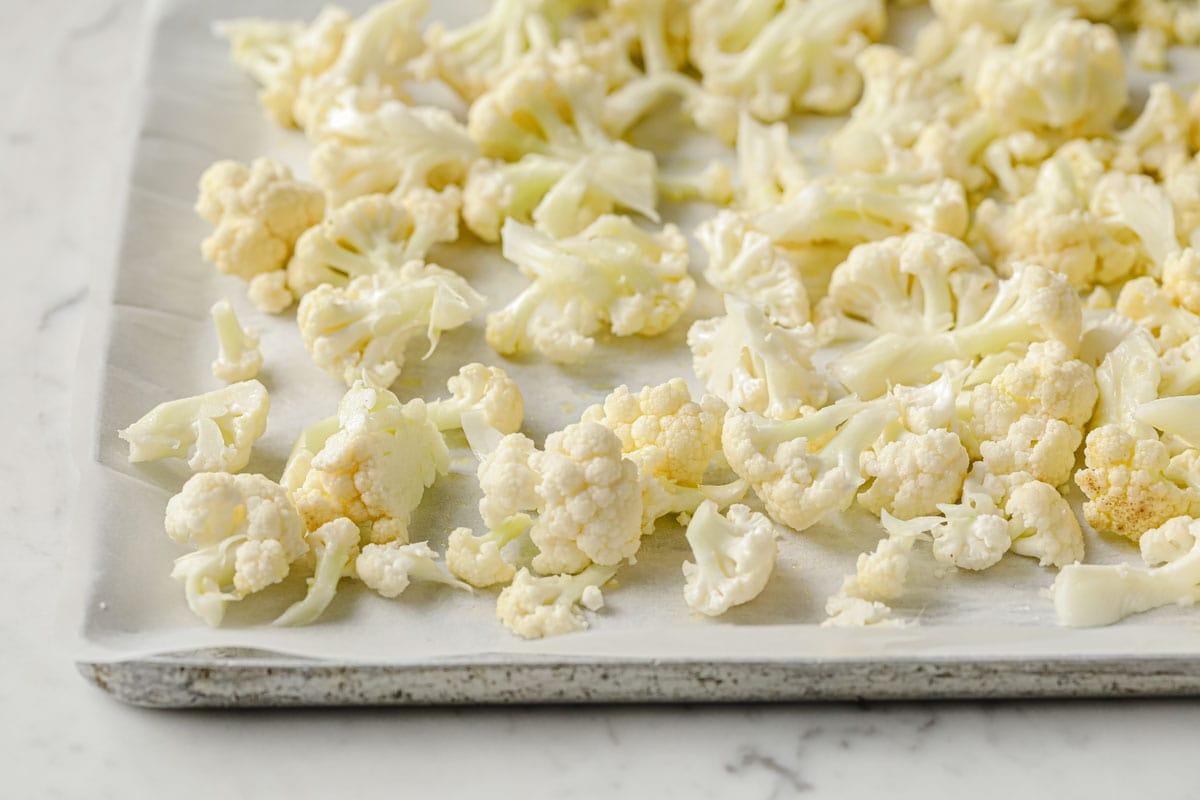 cauliflower florets on parchment paper