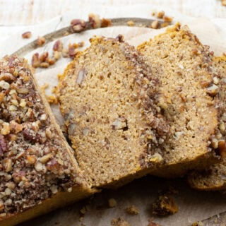 slices of keto pumpkin bread with a pecan nut crust