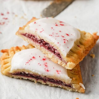 a keto pop tart with raspberry filling and icing sliced in half