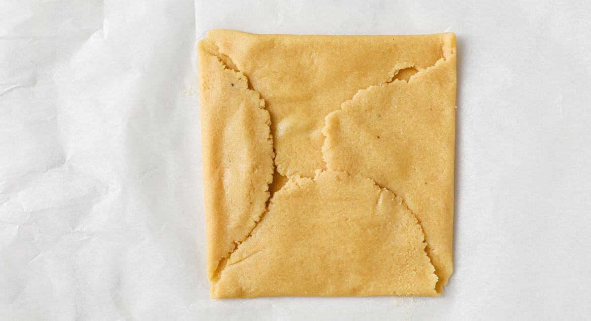folding pastry dough into a square