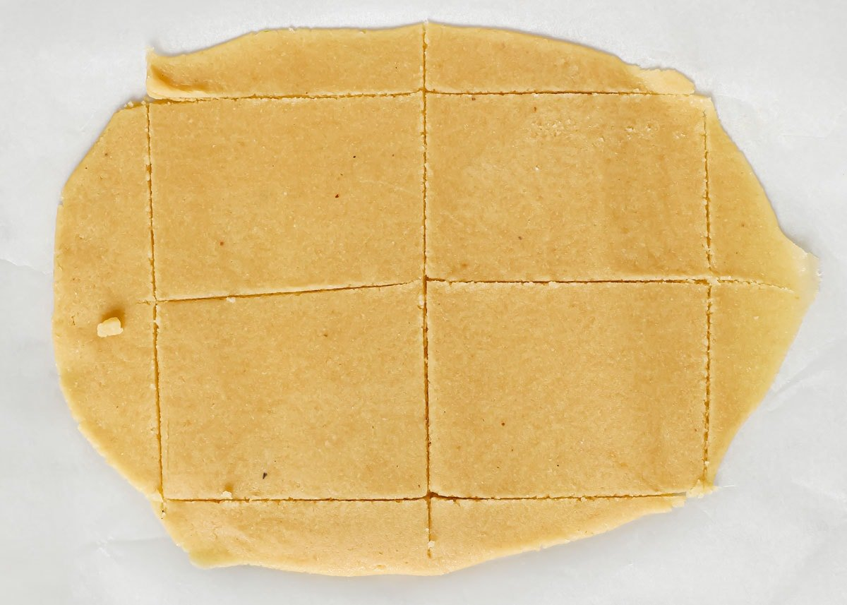 cutting out rectangles from rolled out dough