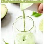 pouring avocado smoothie into a glass