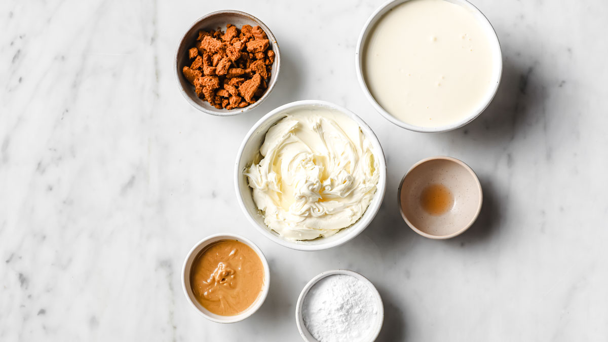 mascarpone, cream, peanut butter and other ingredients measured into bowls