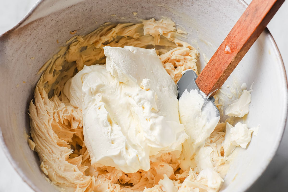 stirring together whipped cream and the mascarpone peanut butter mix