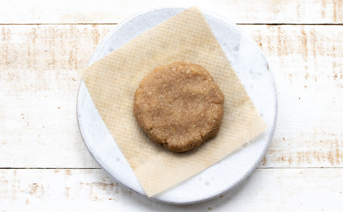 an unbaked cookie on parchment paper