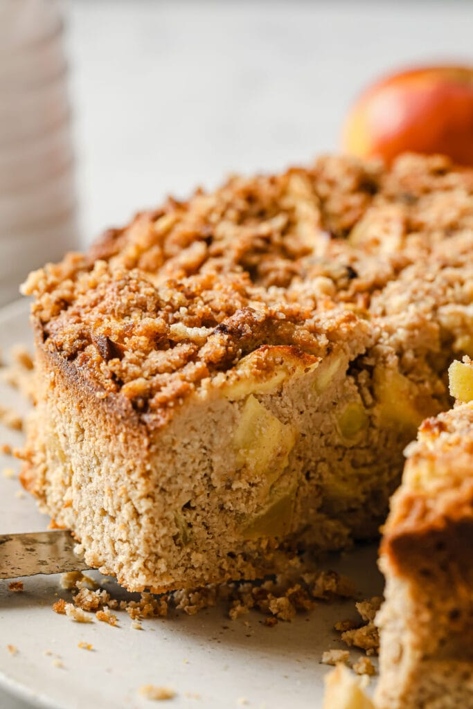 A slice of keto apple cake being lifted