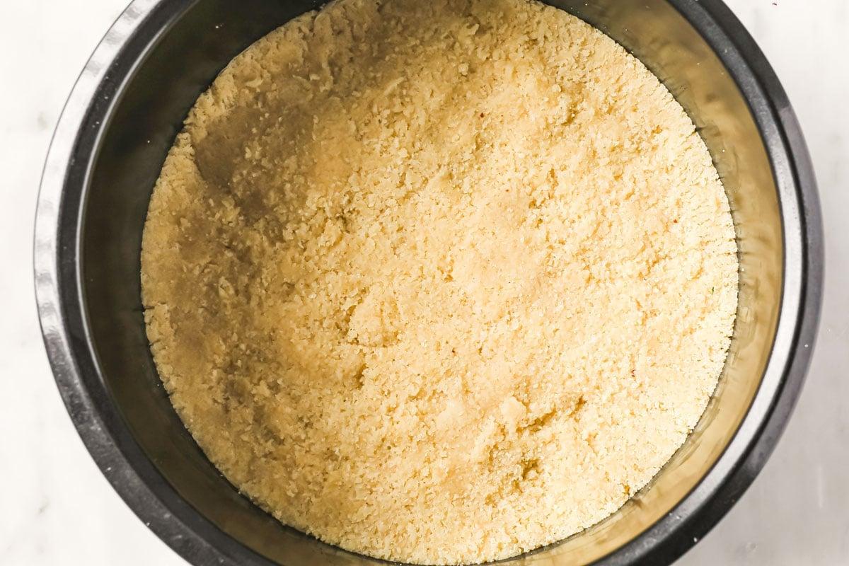 almond flour base in a springform