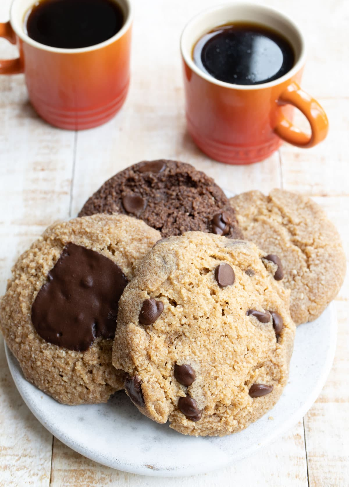 a plate with four cookies