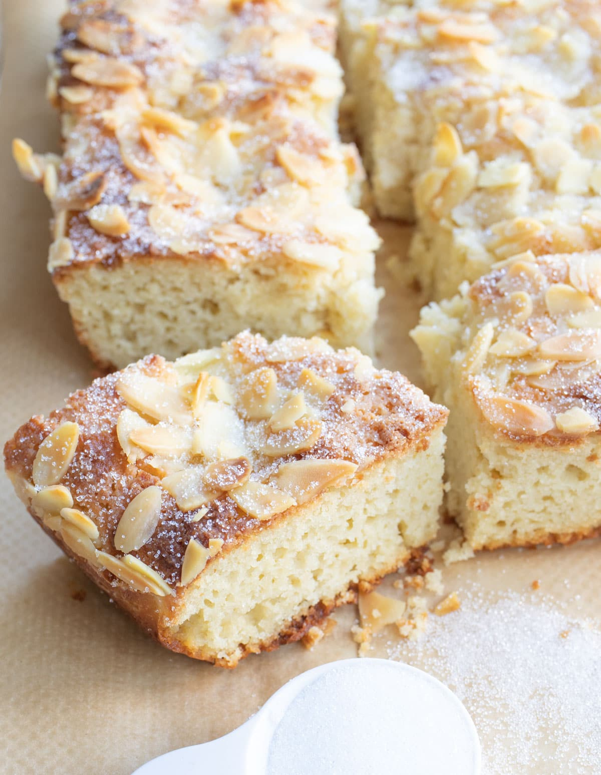 squares of cake topped with almonds and sweetener
