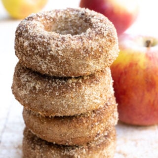 """a stack of keto apple cider donuts coated in cinnamon """"sugar"""""""